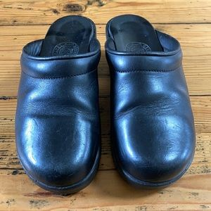 Roots Black Leather Clogs